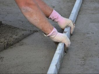 man working a concrete floor