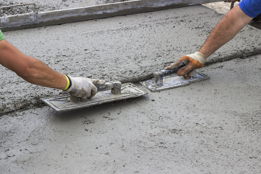 working to make the road concrete